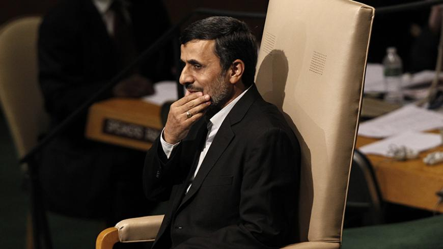 Iran's President Mahmoud Ahmadinejad sits in a chair after addressing the 67th United Nations General Assembly at the U.N. Headquarters in New York, September 26, 2012. REUTERS/Keith Bedford (UNITED STATES - Tags: POLITICS) - RTR38G44