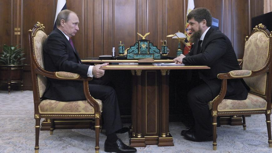 Russian President Vladimir Putin (L) meets with Chechnya's leader Ramzan Kadyrov at the Kremlin in Moscow, Russia, March 25, 2016. REUTERS/Mikhail Klimentyev/Sputnik/Kremlin ATTENTION EDITORS - THIS IMAGE HAS BEEN SUPPLIED BY A THIRD PARTY. IT IS DISTRIBUTED, EXACTLY AS RECEIVED BY REUTERS, AS A SERVICE TO CLIENTS. - RTSC7SC