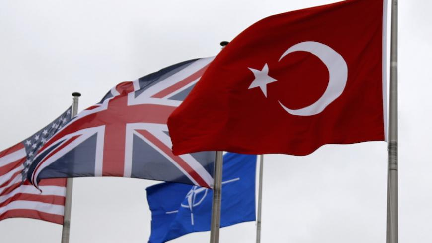A Turkish flag (R) flies among others flags of NATO members during the North Atlantic Council (NAC) following Turkey's request for Article 4 consultations, at the Alliance headquarters in Brussels, Belgium, July 28, 2015. Turkey sought moral support for its campaign against militants in Syria and Iraq at an emergency meeting on Tuesday with its North Atlantic allies, with both NATO and Ankara playing down any idea of a call for military help from the alliance. Turkey requested urgent consultations with its