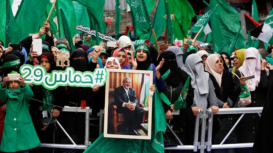 Palestinian Hamas supporters shout slogans during a rally marking the 29th anniversary of the founding of the Hamas movement, in Gaza city December 14, 2016. REUTERS/Suhaib Salem - RTX2UZFP