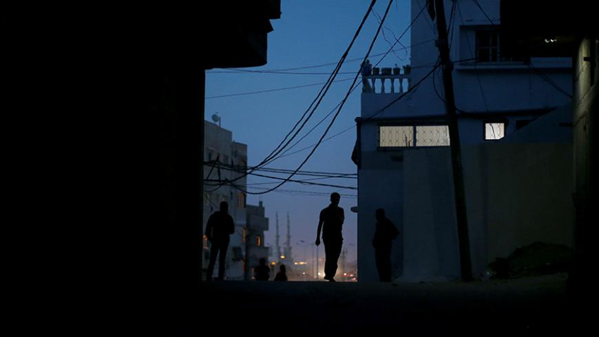A Palestinian man walks during power cut at Shati refugee camp in Gaza City April 25, 2017. Picture taken April 25, 2017. REUTERS/Mohammed Salem - RTS14596