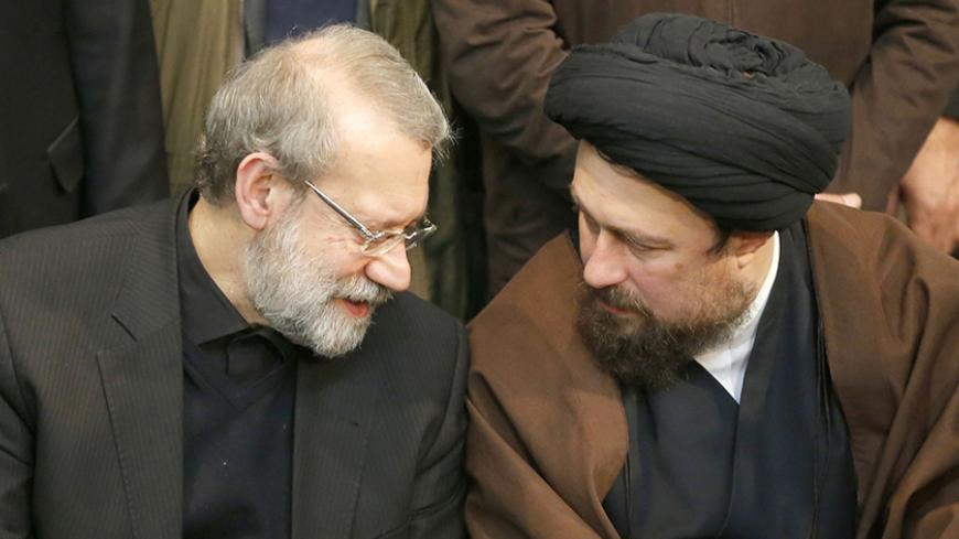 Iranian Parliament speaker Ali Larijani (L) speaks with Hassan Khomeini, grandson of Iran's late founder of the Islamic Republic, during a mourning ceremony for the former Iranian president Akbar Hashemi Rafsanjani at the Jamaran mosque in Tehran on January 9, 2017. Rafsanjani died in hospital on January 8 after suffering a heart attack. Rafsanjani, who was 82, was a pivotal figure in the foundation of the Islamic republic in 1979, and served as president from 1989 to 1997. / AFP / ATTA KENARE        (Photo