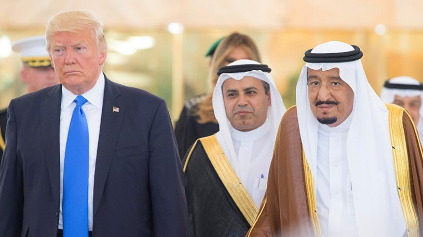 Saudi Arabia's King Salman bin Abdulaziz Al Saud stands next to U.S. President Donald Trump during a reception ceremony in Riyadh, Saudi Arabia, May 20, 2017. Bandar Algaloud/Courtesy of Saudi Royal Court/Handout via REUTERS ATTENTION EDITORS - THIS PICTURE WAS PROVIDED BY A THIRD PARTY. FOR EDITORIAL USE ONLY. - RTX36OPM
