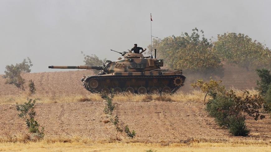 A Turkish army tank drives towards to the border in Karkamis on the Turkish-Syrian border in the southeastern Gaziantep province, Turkey, August 25, 2016. REUTERS/Umit Bektas - RTX2MYWT