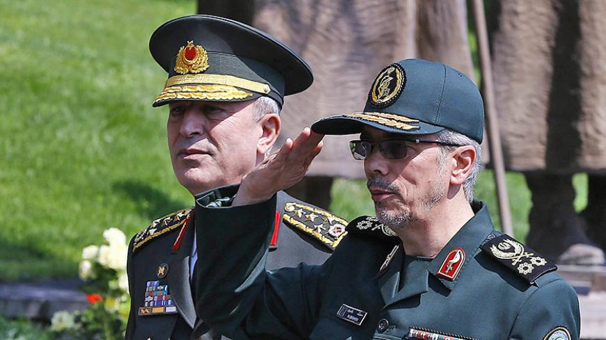 General Staff of the Armed Forces of Iran, Mohammad Bagheri (R) salutes the honor guards as he is welcomed by Chief of the General Staff of the Turkish Armed Forces Hulusi Akar (L) during his official visit at the Turkish General Staff headquarters in Ankara, on August 15, 2017.   / AFP PHOTO / STR        (Photo credit should read STR/AFP/Getty Images)