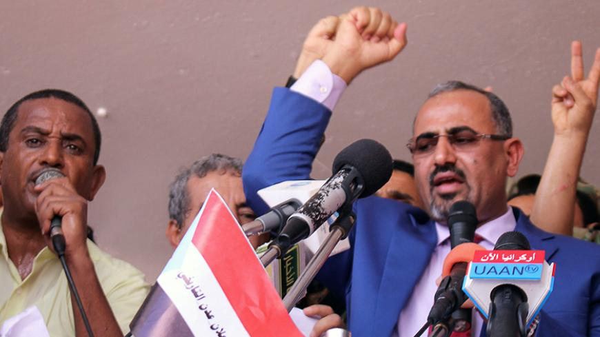 Dismissed governor of the southern Yemeni port city of Aden, Aidaroos al-Zubaidi (R), waves to  supporters of the separatist Southern Movement as they demonstrated against recent decisions by President Abd-Rabbu Mansour Hadi that sacked senior officials supported by the United Arab Emirates, including al-Zubaidi in Aden, Yemen May 4, 2017. REUTERS/Fawaz Salman - RTS154Z1