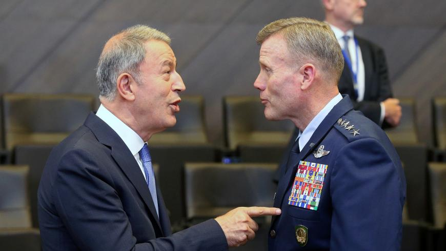 Turkey's Defence Minister Hulusi Akar and Supreme Allied Commander Europe (SACEUR) U.S. Air Force General Tod Wolters attend a NATO Defence Ministers meeting in Brussels, Belgium June 26, 2019. REUTERS/Francois Walschaerts - RC153052BAD0