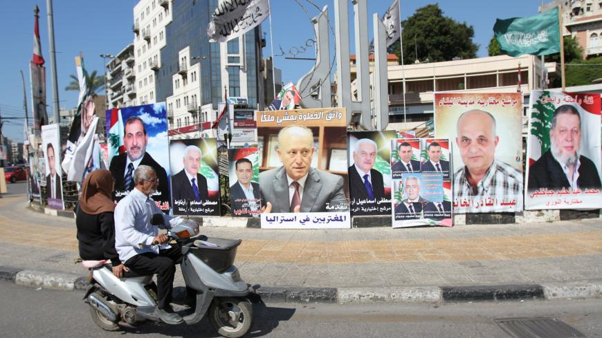 A poster depicting Sunni politician Ashraf Rifi (C) is seen among posters of Lebanese candidates that were running in Tripoli's municipal and mayoral elections, Lebanon, May 30, 2016. REUTERS/Omar Ibrahim - S1BETHAZUQAA