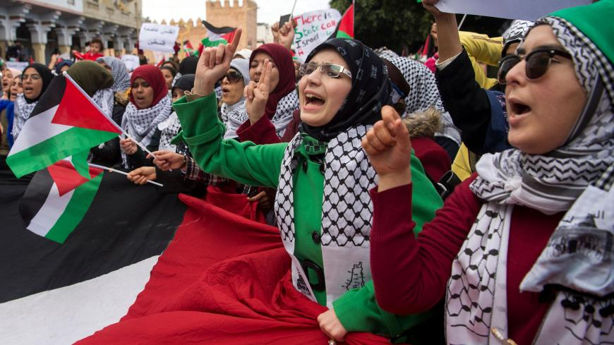 Pro-Palestinian protesters wave Palestinian flags and chant slogans against the US and Israel on December 10, 2017 during a demonstration in Rabat against US President Donald Trump's declaration of Jerusalem as Israel's capital.  / AFP PHOTO / FADEL SENNA        (Photo credit should read FADEL SENNA/AFP/Getty Images)