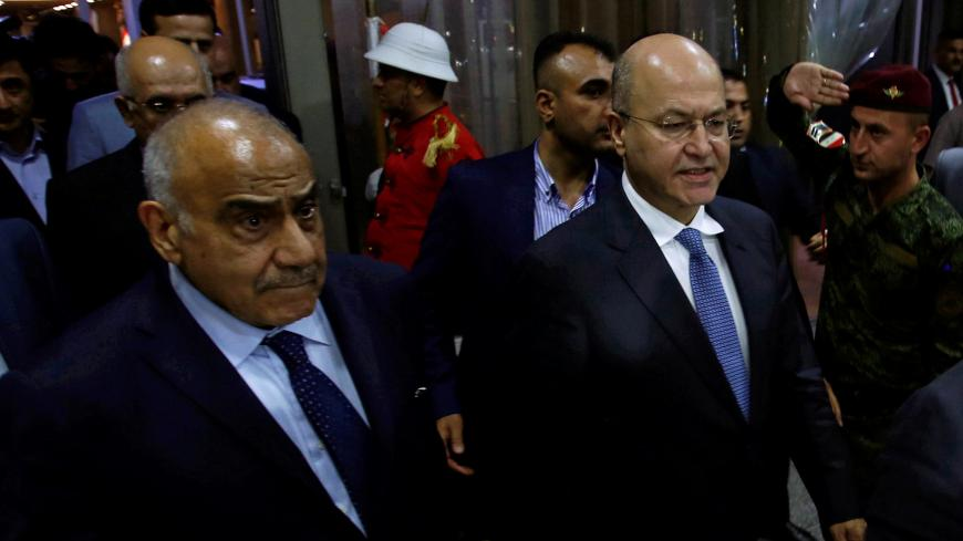 Barham Salih, Iraq's newly elected president, walks with Iraq's new Prime Minister Adel Abdul Mahdi at the parliament headquarters, in Baghdad, Iraq October 2, 2018. REUTERS/Khalid al Mousily - RC14461FCEC0