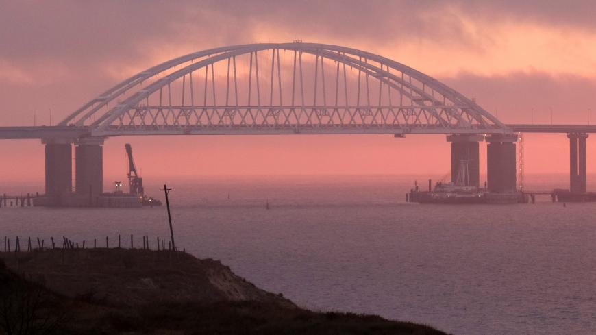 A general view shows a road-and-rail bridge, which is constructed to connect the Russian mainland with the Crimean peninsula, at sunrise in the Kerch Strait, Crimea November 26, 2018. REUTERS/Pavel Rebrov - RC1C9CFF8770