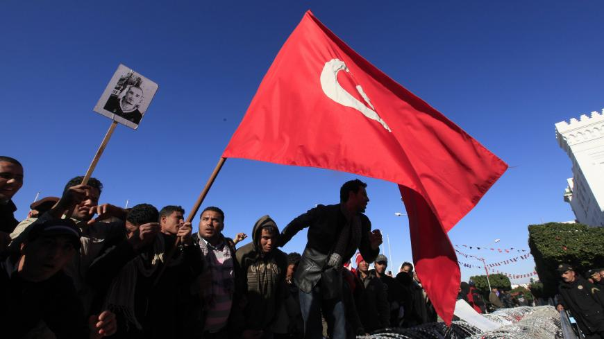 Protesters from Tunisia's poor rural heartlands chant slogans during a demonstration by the Prime Minister's office in Tunis January 23, 2011. Protesters from Tunisia's poor rural heartlands demonstrated in the capital on Sunday to demand that the revolution they started should now sweep the remnants of the fallen president's old guard from power. REUTERS/Zohra Bensemra (TUNISIA - Tags: POLITICS CIVIL UNREST) - GM1E71O00LX01