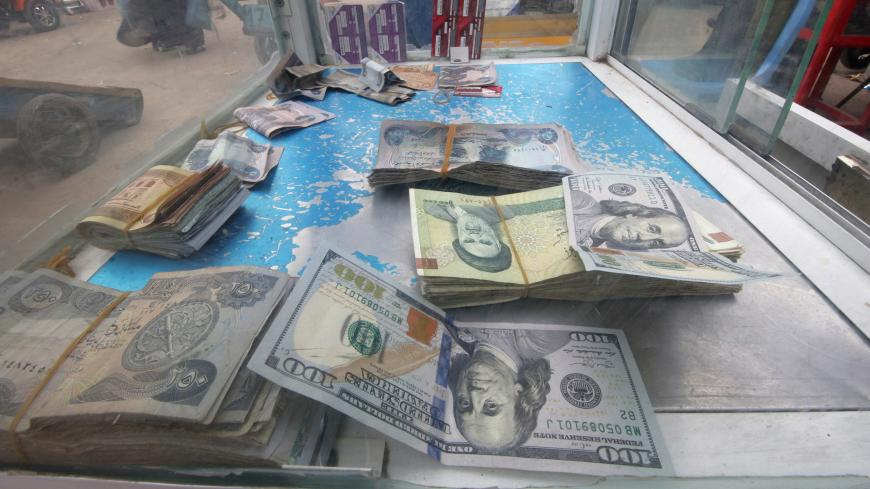 Iranian rials, U.S. dollars and Iraqi dinars are seen at a currency exchange shop in Basra, Iraq November 3, 2018. Picture taken November 3, 2018. REUTERS/Essam al-Sudani - RC1645948610