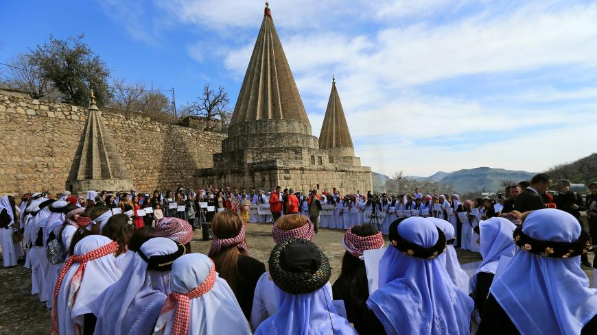 Yazidi's women attend a ceremony at Lilash Temple to commemorate the death of women who were killed by Islamic State militants, during the International Women Day, in Shikhan north of Iraq March 8, 2019. REUTERS/Ari Jalal - RC119D479580