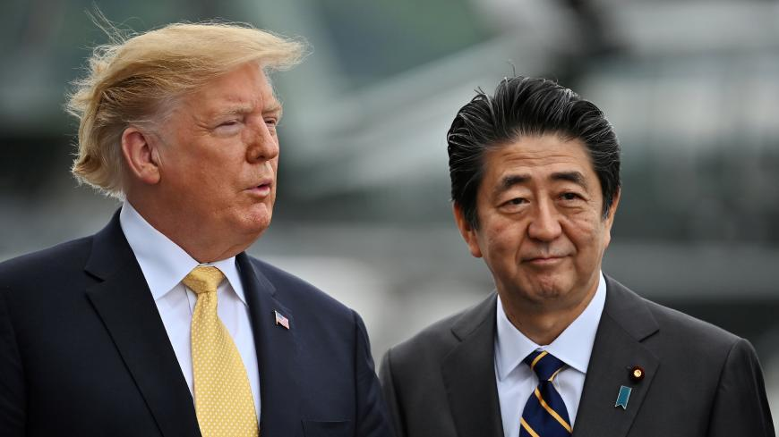 U.S. President Donald Trump and Japanese Prime Minister Shinzo Abe onboard the Japan's navy ship Kaga on May 28, 2019 in Yokosuka, Japan. Charly Triballeau/Pool via REUTERS      TPX IMAGES OF THE DAY - RC1356757C20