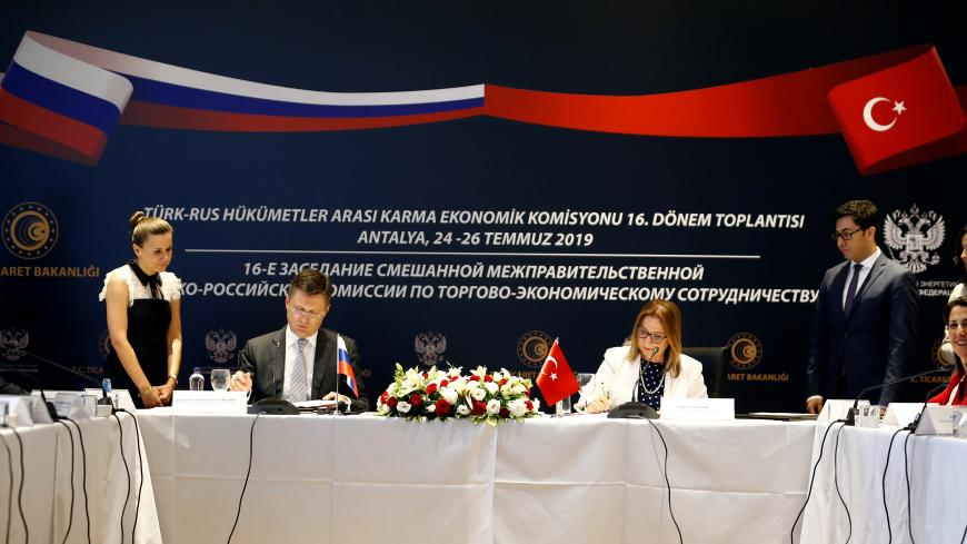 ANTALYA, TURKEY - JULY 26 : Turkish Trade Minister Ruhsar Pekcan (2nd R) and Minister of Energy of Russia, Alexander Novak (2nd L) sign a protocol at the end of the 16th Term meeting of Turkey-Russia Inter-governmental Joint Economic Commission in Antalya, Turkey on July 26, 2019. (Photo by Mustafa Ciftci/Anadolu Agency via Getty Images)