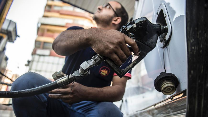 An Egyptian petrol station worker fills up a vehicle's tank in the capital Cairo on June 29, 2017. Egypt announced a new sharp increase in fuel prices as it slashed government subsidies in a tough IMF-backed reform programme.  / AFP PHOTO / KHALED DESOUKI        (Photo credit should read KHALED DESOUKI/AFP/Getty Images)