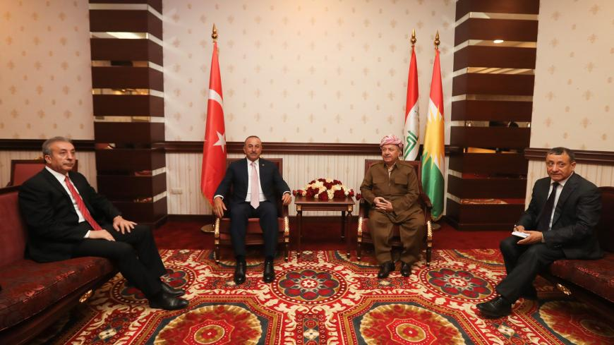 ERBIL, IRAQ  - JUNE 10: Turkish Foreign Minister Mevlut Cavusoglu (2L) meets KDP Leader Masoud Barzani (2R) in Erbil, Iraq on June 10, 2019.  (Photo by Cem Ozdel/Anadolu Agency/Getty Images)