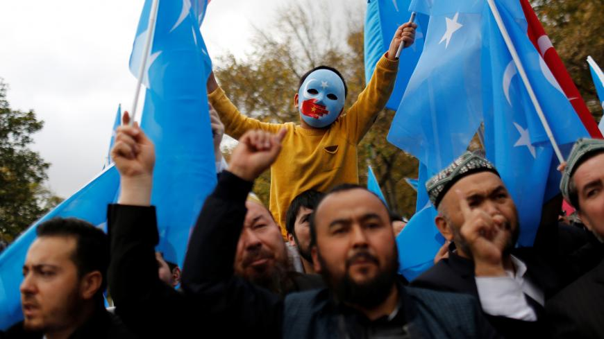 "A masked Uighur boy takes part in a protest against China, at the courtyard of Fatih Mosque, a common meeting place for pro-Islamist demonstrators in Istanbul, Turkey, November 6, 2018. REUTERS/Murad Sezer  SEARCH ""SEZER NOURMUHAMMED"" FOR THIS STORY. SEARCH ""WIDER IMAGE"" FOR ALL STORIES. TPX IMAGES OF THE DAY. - RC1EFCCF5820"