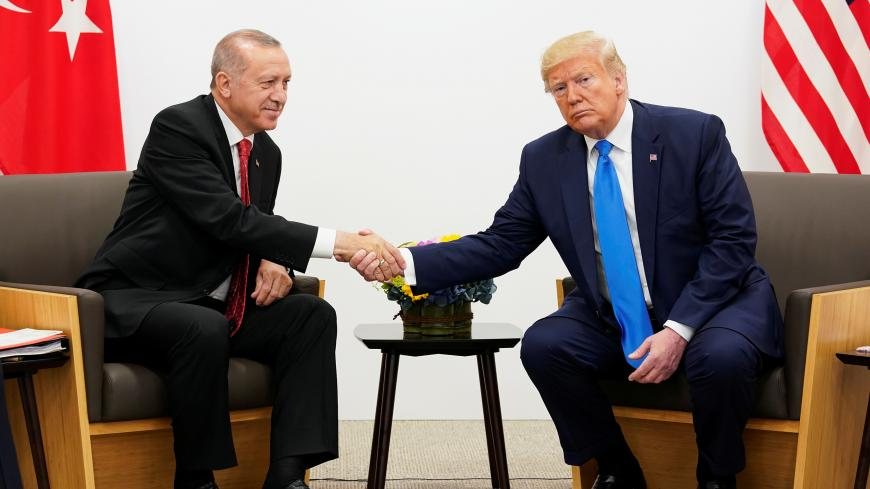 U.S. President Donald Trump shakes hands during a bilateral meeting with Turkey's President Tayyip Erdogan during the G20 leaders summit in Osaka, Japan, June 29, 2019. REUTERS/Kevin Lamarque - RC1DDD25D480
