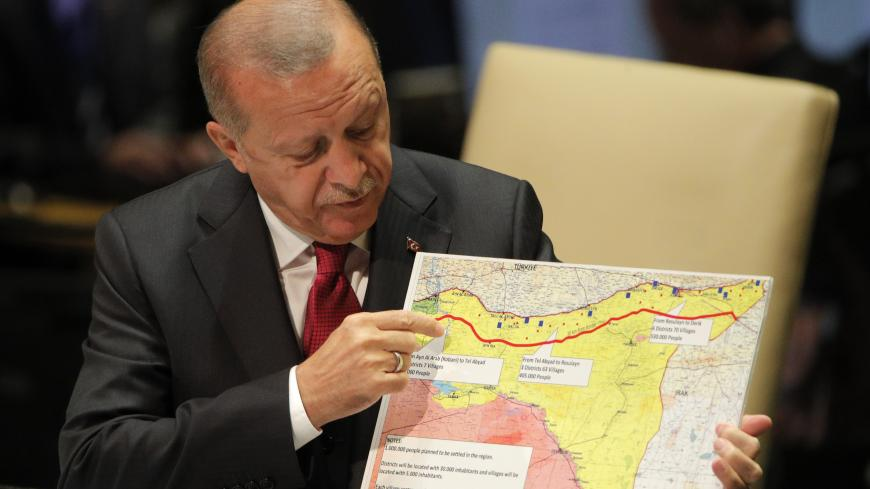 Turkey's President Recep Tayyip Erdogan holds up a map as he addresses the 74th session of the United Nations General Assembly at U.N. headquarters in New York City, New York, U.S., September 24, 2019. REUTERS/Brendan Mcdermid - HP1EF9O181E99