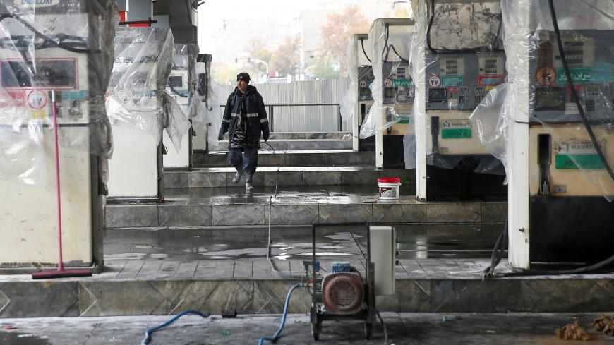 A man walks near the remains of gas pump stands, during protests against increased fuel prices, in Tehran, Iran November 20, 2019. Picture taken November 20, 2019. Nazanin Tabatabaee/WANA (West Asia News Agency) via REUTERS ATTENTION EDITORS - THIS IMAGE HAS BEEN SUPPLIED BY A THIRD PARTY - RC2CGD9I6P5F