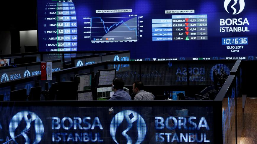 Traders work at their desks on the floor of the Borsa Istanbul in Istanbul, Turkey October 13, 2017. REUTERS/Murad Sezer - RC1141900C40