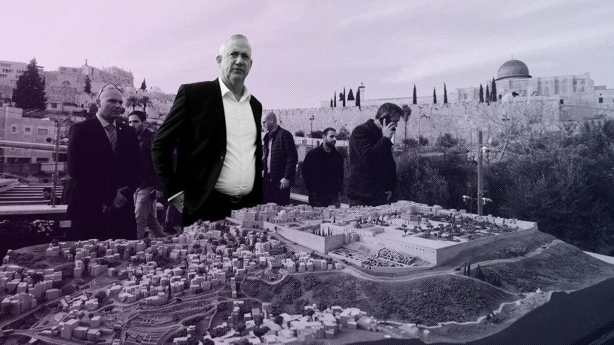 "Benny Gantz, leader of Blue and White party, stands behind a model of Jerusalem's Old City and surrounding areas as he tours ""The City of David"", a Jewish heritage site in Silwan, East Jerusalem January 14, 2020. REUTERS/Ammar Awad - RC2QFE9ITSWC"