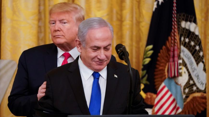 U.S. President Donald Trump puts his hands on Israel's Prime Minister Benjamin Netanyahu's shoulders as they deliver joint remarks on a Middle East peace plan proposal in the East Room of the White House in Washington, U.S., January 28, 2020. REUTERS/Joshua Roberts? - RC27PE95YQQU