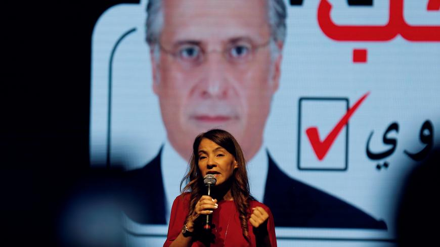 Salwa Karoui, wife of detained Tunisian media mogul and presidential candidate Nabil Karoui, speaks during an election campaign rally in Tunis, Tunisia, September 13, 2019. REUTERS/Zoubeir Souissi - RC1981714B10