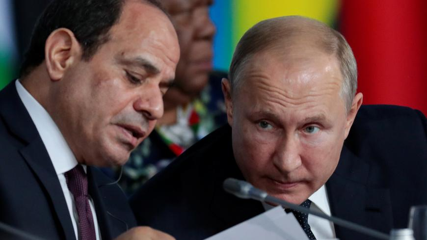 Egypt's President Abdel Fattah el-Sisi speaks with Russia's President Vladimir Putin during the first plenary session as part of the 2019 Russia-Africa Summit at the Sirius Park of Science and Art in Sochi, Russia, October 24, 2019. Sergei Chirikov/Pool via REUTERS - RC1AA9297200