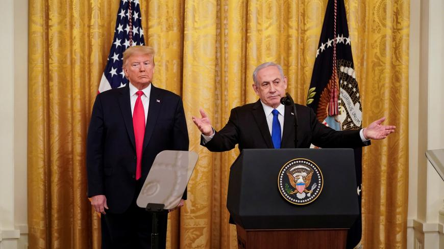 U.S. President Donald Trump and Israel's Prime Minister Benjamin Netanyahu deliver joint remarks on a Middle East peace plan proposal in the East Room of the White House in Washington, U.S., January 28, 2020. REUTERS/Joshua Roberts? - RC27PE93LVFU