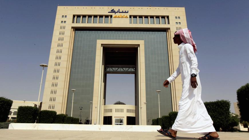 A man walks past the headquarters of Saudi Basic Industries Corp (SABIC) in Riyadh, Saudi Arabia October 27, 2013. REUTERS/Faisal Al Nasser/File Photo     TPX IMAGES OF THE DAY      - S1BETCCGREAA