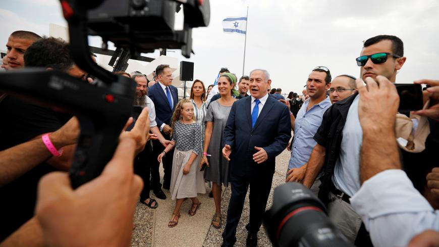 Members of the media work as Israeli Prime Minister Benjamin Netanyahu walks after holding a weekly cabinet meeting in the Jordan Valley, in the Israeli-occupied West Bank September 15, 2019. REUTERS/Amir Cohen - RC1DC97D0610