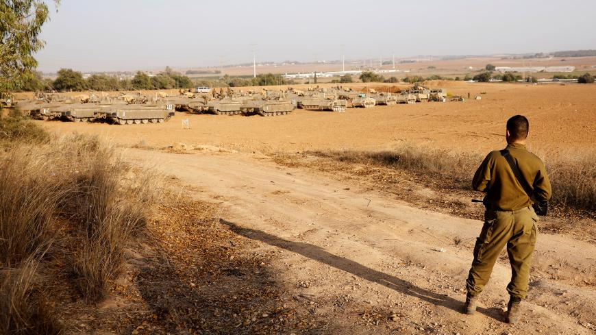 An Israeli soldier stands near a staging area near the border with Gaza, in southern Israel November 14, 2019. REUTERS/ Ronen Zvulun - RC21BD9513VS