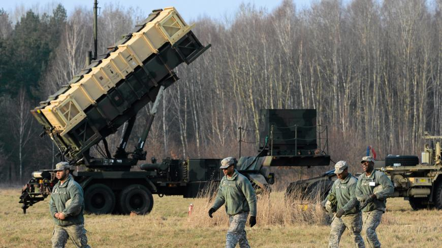 U.S soldiers walk next to  a Patriot missile defence battery during join exercises at the military grouds in Sochaczew, near Warsaw, March 21, 2015. The U.S. Army Europe has deployed a Patriot missile defence battery as part of joint exercises with Poland aimed at reassuring the NATO member in light of the conflict in neighbouring Ukraine. Picture taken March 21, 2015.   REUTERS/Franciszek Mazur/Agencja Gazeta  THIS IMAGE HAS BEEN SUPPLIED BY A THIRD PARTY. IT IS DISTRIBUTED, EXACTLY AS RECEIVED BY REUTERS,
