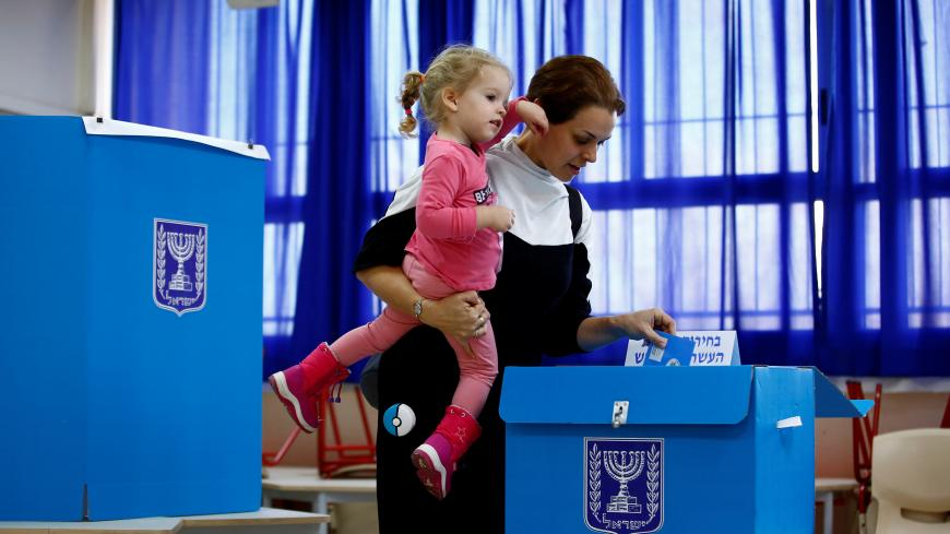 A woman casts her ballot as she votes in Israel's national election at a polling station in Tel Aviv, Israel March 2, 2020. REUTERS/Corinna Kern - RC2MBF9DATS2