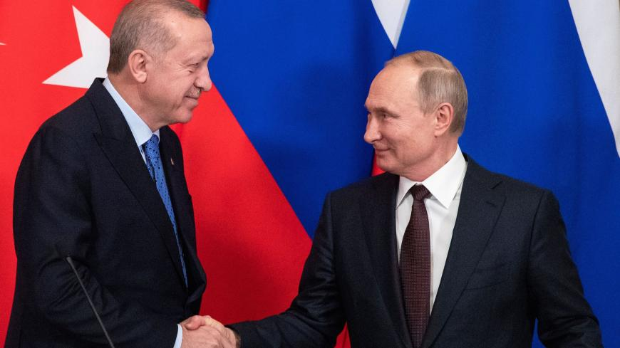 Russian President Vladimir Putin and Turkish President Tayyip Erdogan shake hands during a news conference following their talks in Moscow, Russia March 5, 2020. Pavel Golovkin/Pool via REUTERS - RC2UDF91Q123