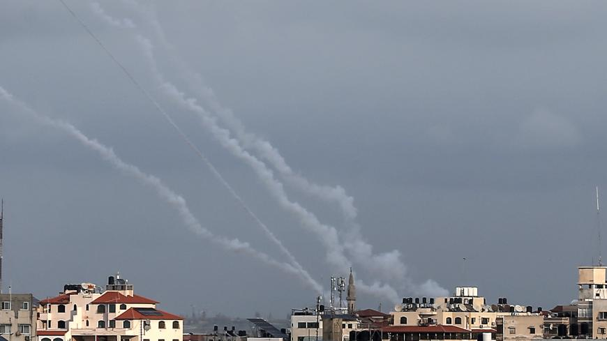 "This picture taken on February 24, 2020, shows smoke trails from rockets fired by Palestinian militants in Gaza City. - Islamic Jihad militants claimed responsibility for another round of rockets fired towards Israel on February 24 following a new flare-up between the group and the Jewish state. Israel's army said six ""projectiles"" had been fired from Gaza, but that its air defence systems had ""intercepted five of the launches."" (Photo by MAHMUD HAMS / AFP) (Photo by MAHMUD HAMS/AFP via Getty Images)"