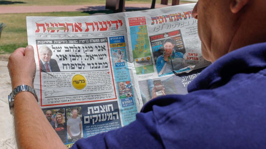 "The front page of Israel's daily Yedioth Ahronoth, the country's leading daily newspaper, shows a headline from an interview by British Prime Minister Boris Johnson reading in Hebrew: ""I am passionate defender of Israel that's why I oppose the annexation"", in Jerusalem on July 1, 2020. - The government of Israeli Prime Minister Benjamin Netanyahu has said it could begin the process to annex Jewish settlements in the West Bank as well as the strategic Jordan Valley from today. The plan -- endorsed by Washing"