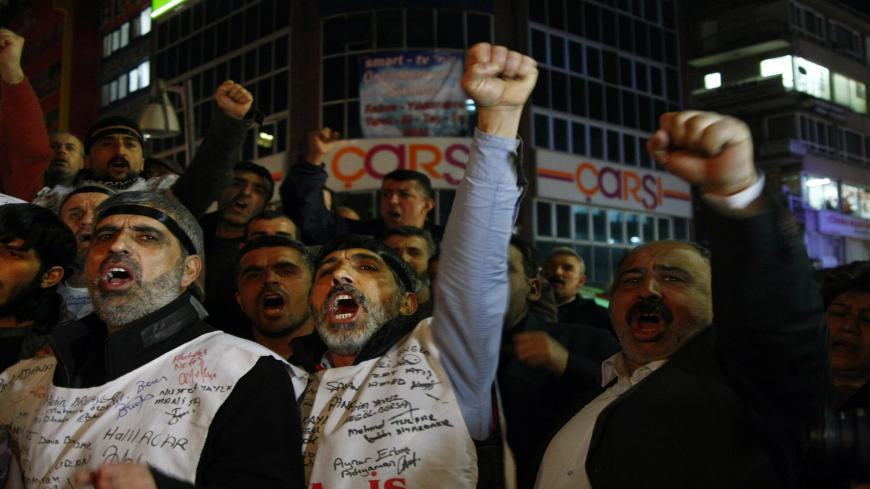 Turkish workers of former state-owned tobacco and alcohol monopoly TEKEL shout slogans in protest against layoffs and the government�s labor policy on the 65th day of their strike in Ankara on February 18, 2010. Workers are demonstrating for the rights of some 10,000 workers who were made redundant by the privatization of the state tobacco monopoly TEKEL in 2008. AFP PHOTO/ADEM ALTAN (Photo credit should read ADEM ALTAN/AFP via Getty Images)