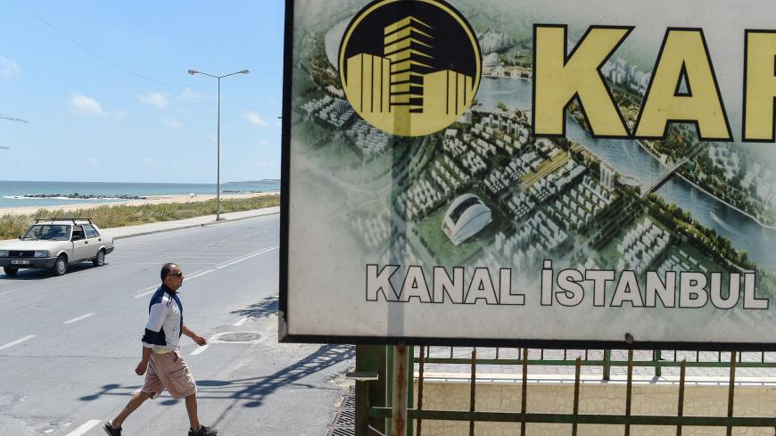 A real estate advertising offers apartments with the view on the canal, in the small coastal village of Karaburun, near Istanbul, on June 12, 2018. - Karaburun's residents are waiting if a controversial new canal that will be built for Istanbul will change the region for the good. The ambitious Canal Istanbul project, first announced by Turkish current President in 2011 when he was prime minister, would begin in the Istanbul district of Kucukcekmece and then head toward Sazlidere reservoir before emerging i