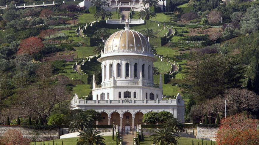 A general view shows the terraced gardens and the golden Shrine of Bab following renovation works at the Bahai World Center, in the Israeli port city of Haifa, on April 12, 2011. The restoration work in the Bahai Faith second holiest site began in 2008 and was carried out by volunteers from Mongolia, China, Ecuador, Kenya, Germany, Canada, U.S, South Africa, Vanuatu, India and New Zealand . The gardens, tucked into the steep slopes of mount Carmel, are designed in nine concentric circles around the shrine w