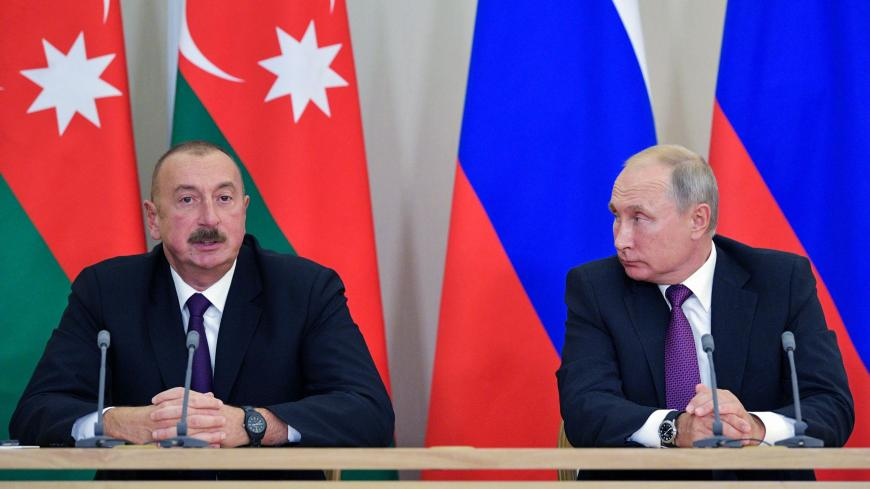 Azeri President Ilham Aliyev (L) talks during his meeting with Russian President Vladimir Putin in Sochi on September 1, 2018. (Photo by Alexey DRUZHININ / Sputnik / AFP)        (Photo credit should read ALEXEY DRUZHININ/AFP via Getty Images)