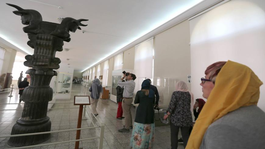 Tourists visit The National Museum of Iran in Tehran on October 09, 2018. (Photo by ATTA KENARE / AFP)        (Photo credit should read ATTA KENARE/AFP via Getty Images)