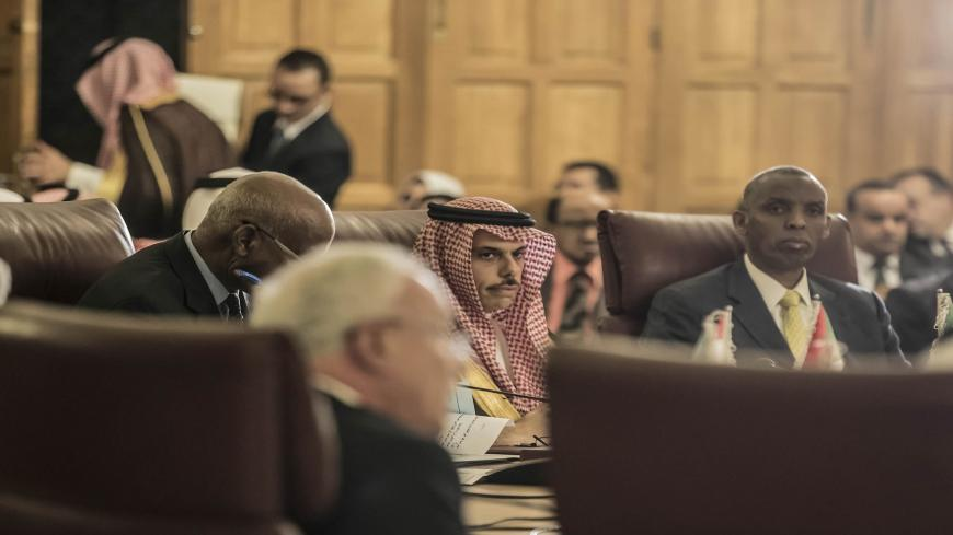 "Saudi Foreign Minister Faisal Bin Farhan (C) attends an emergency meeting at the Arab League headquarters in the Egyptian capital Cairo, on November 25, 2019, to discuss the US decision to no longer consider Israeli settlements in Palestinian Territories illegal. - US Secretary of State Mike Pompeo said on October 18 that after legal consultations, that Washington had concluded the establishment of settlements was ""not, per se, inconsistent with international law"". (Photo by Khaled DESOUKI / AFP) (Photo by"