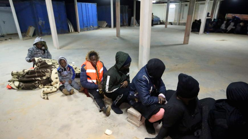 Migrants are pictured in the Libyan town of Tajura, about 14 kilometres east of the capital Tripoli, after some 240 illegal migrants of different African nationalities were rescued from the Mediterranean late on February 18, 2020. (Photo by Mahmud TURKIA / AFP) (Photo by MAHMUD TURKIA/AFP via Getty Images)