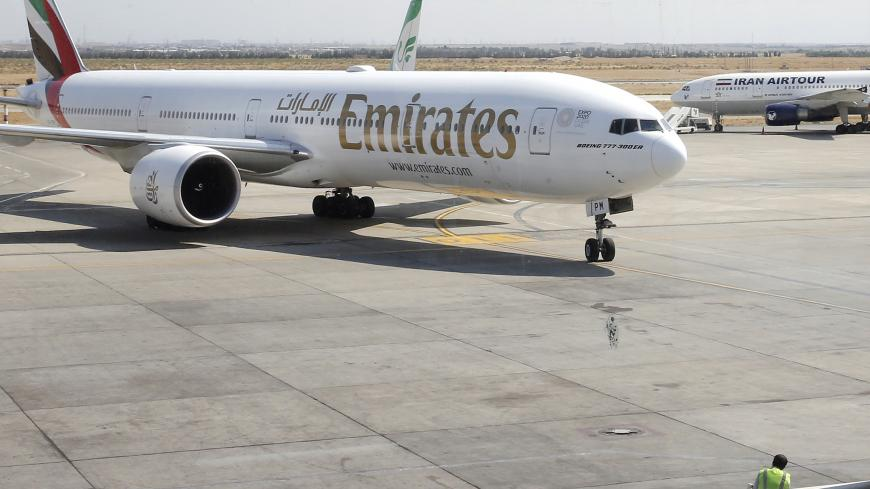 This picture taken on July 17, 2020 shows an Emirates Boeing 777-31H aircraft taxying upon arrival at the Iranian capital Tehran's Imam Khomeini International Airport. - The UAE's Emirates airlines landed its first flight in Tehran on July 17 after a five month shutdown due to the novel coronavirus pandemic. (Photo by - / AFP) (Photo by -/AFP via Getty Images)