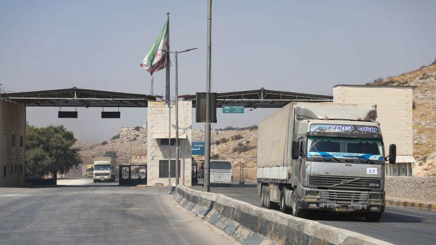 International humanitarian aid trucks cross into Syria's northwestern Idlib province through the Bab al-Hawa border crossing with Turkey, on September 7, 2020. (Photo by AAREF WATAD / AFP) (Photo by AAREF WATAD/AFP via Getty Images)