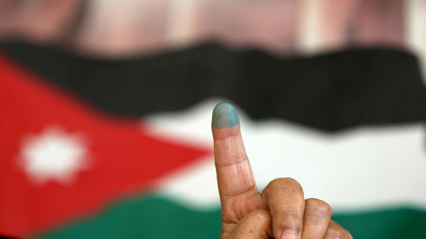 A Jordanian woman shows her ink-stained finger after casting her vote in the parliamentary elections at a polling station in the capital Amman on September 20, 2016.   Jordanians are voting in an election that could see opposition Islamists re-emerge as a major parliamentary force in the key Western ally.   / AFP / Khalil MAZRAAWI        (Photo credit should read KHALIL MAZRAAWI/AFP via Getty Images)